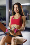 Sporty sexy woman posing in gym Stock Photos