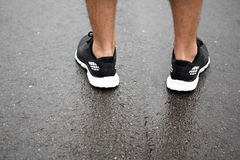 Sporty shoes on pavement Royalty Free Stock Photo