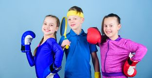 Sporty siblings. Girls kids with boxing sport equipment and boy tennis player. Ways to help kids find sport they enjoy. Friends ready for sport training. Child royalty free stock photos