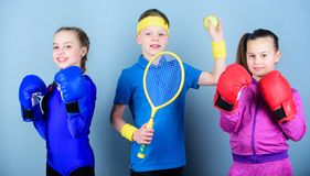 Sporty siblings. Ways to help kids find sport they enjoy. Friends ready for sport training. Child might excel completely royalty free stock photos