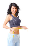Sporty slim girl. Sporty girl measuring her weist with tape, weight loss Royalty Free Stock Image