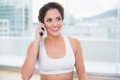 Sporty smiling brunette phoning Stock Photo