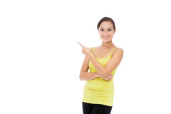 Sporty smiling woman presenting Stock Photography