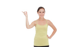 Sporty smiling woman presenting Royalty Free Stock Images