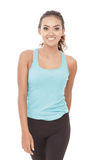 Sporty styles woman in walking pose while smiling. Portrait of sporty styles woman in walking pose while smiling on white background stock photos