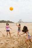 Sporty teen girls. Three sporty teen girls playing volleyball on the beach Stock Image