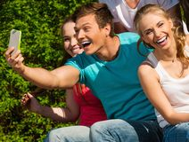 Sporty teenage friends in a park Stock Images