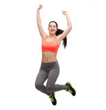 Sporty teenage girl jumping in sportswear Stock Photo