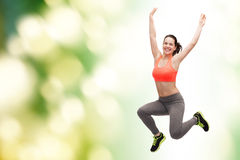 Sporty teenage girl jumping in sportswear Royalty Free Stock Image