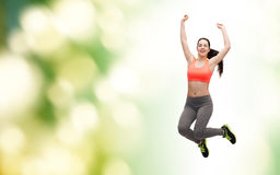 Sporty teenage girl jumping in sportswear Stock Image