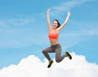 Sporty teenage girl jumping in sportswear Stock Image
