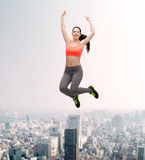 Sporty teenage girl jumping in sportswear Royalty Free Stock Images