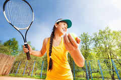 Sporty teenage girl preparing to serve on a court Royalty Free Stock Photo