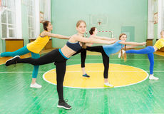 Sporty teenage girls standing in pose of swallow Stock Images