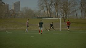Sporty teenagers playing soccer on the sports field stock footage