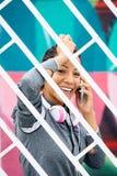 Sporty urban woman on cellphone call Stock Photos