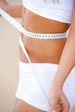 Sporty waist is being measured Stock Images