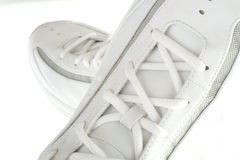 Sporty white sneakers. Close up on a pair of basketball shoes Stock Photos
