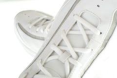 Sporty white sneakers Stock Photos