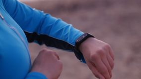 Sporty woman with activity tracker. Close up stock video