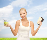 Sporty woman with apple and chocolate bars Stock Photo