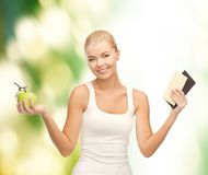 Sporty woman with apple and chocolate bars Royalty Free Stock Images