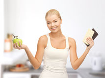 Sporty woman with apple and chocolate bars Royalty Free Stock Photo