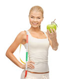 Sporty woman with apple and measuring tape Royalty Free Stock Photo