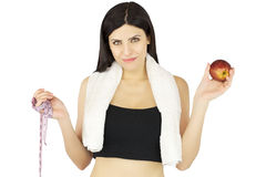 Sporty woman with apple and meter in hand Royalty Free Stock Image