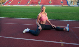 Sporty woman on athletic race track Royalty Free Stock Photos