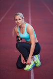 Sporty woman on athletic race track Royalty Free Stock Image