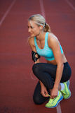 Sporty woman on athletic race track Stock Images