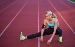 Sporty woman on athletic race track Royalty Free Stock Photo