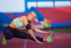 Sporty woman on athletic race track Royalty Free Stock Images