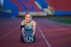Sporty woman on athletic race track Stock Photo