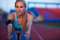 Sporty woman on athletic race track Stock Photography