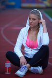 Sporty woman on athletic race track Stock Image