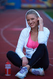 Sporty woman on athletic race track Royalty Free Stock Photography