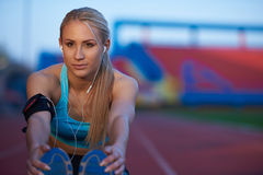 Sporty woman on athletic race track Stock Photos