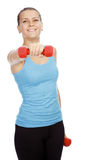 Sporty woman with barbells in hands Royalty Free Stock Photo