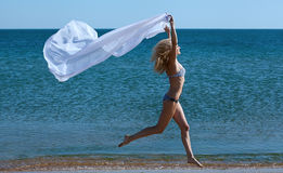 Sporty woman on beach Royalty Free Stock Photos