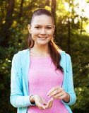 Sporty woman with berries outdoor royalty free stock photo