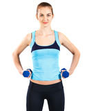 Sporty woman with blue barbells Stock Photography