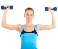 Sporty woman with blue barbells Stock Image