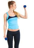Sporty woman with blue barbells Stock Photo