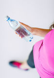 Sporty woman with bottle of water Stock Images