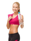 Sporty woman with bottle of water and towel Stock Photography