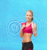Sporty woman with bottle of water and towel Stock Image