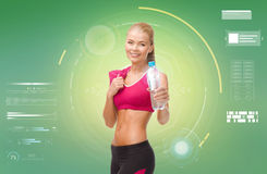 Sporty woman with bottle of water and towel Stock Photo