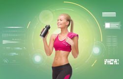 Sporty woman with bottle of water and towel Royalty Free Stock Images